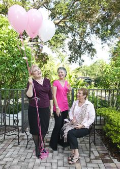 """Heidi Edelmayer, left, Sonia Convery and Joan Farley have a laugh while on set of the photo shoot for Sun Sentinel's """"Party in Pink,"""" which will take place on Oct. 23 at 110 Tower located in Fort Lauderdale. Benefiting Gilda's Club South Florida, the event will feature E!'s Giuliana Rancic who will share her experience overcoming breast cancer. The evening will also celebrate Sun Sentinel Life's Victories cancer survivors. Photo by Kara Starzyk."""