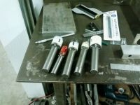 Homemade tube notcher constructed from steel stock, bushings, shafting, and a hole saw. Homemade Tube, Steel Stock