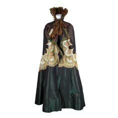 Victorian Iridescent Silk Taffeta Cape w/Floral inserts | From a collection of rare vintage coats and outerwear at http://www.1stdibs.com/fashion/clothing/coats-outerwear/