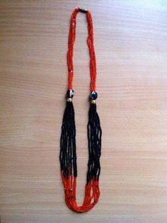 Handmade beaded necklace, red/black. 100% of sales go to support the Youth Education Network of Kenya - www.yenkenya.org