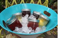 Cute party idea...serve pre-made cocktails (aka. sangria) in mason jars and throw into an ice bucket. No bartender needed!
