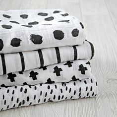 Wrap your new baby up tight in Land of Nod swaddle blankets and baby blankets.