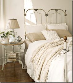 love the delicate high headboard; you can't go wrong with neutrals