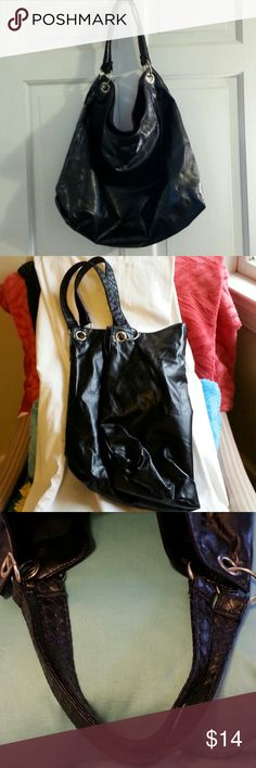 """LADIES HANDBAG BLACK FAUX LEATHER LADIES BLACK HANDBAG. LOOKS AND FEELS LIKE A BEAUTIFUL SOFT LEATHER. HAS DOUBLE BRAIDED STRAPS WITH BEAUTIFUL SILVER TONE DECORATIVE HARD WEAR. HAS ONE ZIPPERED INSIDE POCKET. VERY SIMPLISTIC. SOMETHING YOU WOULD LOVE TO GRAB ON YOUR WAY OUT OF THE DOOR FOR WORK, SCHOOL, BABY... WHATEVER. NEW. NO TAGS. DOUBLE STRAPS ARE 7 1/2 """",  16"""" DEPTH, 19"""" DEPTH. VERY ROOMY AND LIGHT AS A FEATHER. Bags Hobos"""