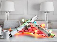 Use vintage-style multicolored twinkle lights to bring unstructured, urban holiday touches to everyday objects.