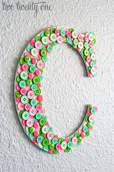 Button Monogram - Want to make one of these for Mia & for Ava with buttons in the colors of their rooms
