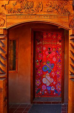 Striking painted red door in Taos, New Mexico. travel. doors of the world. United States.