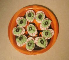 Halloween Eyeballs The Better To See You With - Make some delicious and creepy Halloween recipes.  These are deviled egg eyeballs.