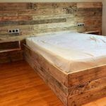 Repurposed Pallet Bed with Wall Headboard
