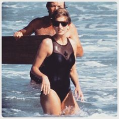 03 January 1993: A relaxed and slim Diana pictured swimming at the island of Nevis, in the Caribbean. Seen in the background is Diana's close friend Catherine Soames's husband.