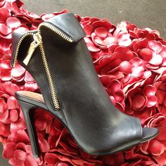 Love the zip detail on these peep-toe booties.