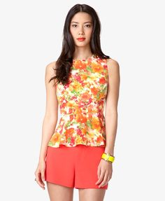 I have this watercolor peplum top...and love it! cute with white jeans and nude wedges =)