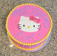 Hot pink Hello Kitty birthday cake with a pink sparkly bow