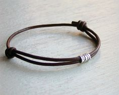 Sterling Silver Tube Bead Leather Bracelet (2 style beads and 13 colors of cords to choose) on Etsy, $8.75