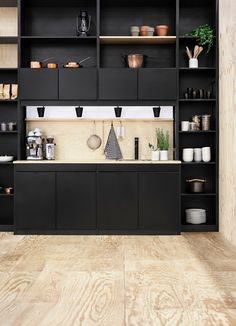 Scandinavian Kitchen Designs-16-1 Kindesign - Black cabinet/light wood floor. Tall shelving to utilize space