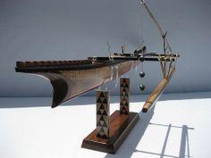 Scale model of a fully planked Samoan Fishing canoe.