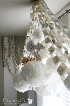 I love paper chains & have Always wanted to hang them in my house! I am SO making some of these! guest-room-book-page-paper-chain Easy Crafts, Diy And Crafts, Jones Design Company, Paper Pom Poms, Tissue Paper, Origami, Paper Chains, Book Pages, Book Crafts