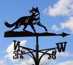 Foxes are traditional and popular on weathervanes, - I call this one Yonder Fox.