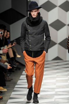 FALL 2013 MENSWEAR Robert Geller /  Berlin in the 1920s is as much a state of mind as a place in time: creative, experimental, excessive, decadent, with the Nazi era on the horizon to add an edge of inescapable doom to the entire Weimar enterprise. Robert Geller has touched on this shadowy sensibility often in his work, but tonight he claimed direct inspiration, particularly from the mood of the movies that were produced in Berlin at the time.
