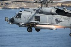 An MH-60R Sea Hawk helicopter, assigned to Helicopter Maritime Strike Squadron (HSM) 35, fires an AGM-114M Hellfire missile near San Clemente Island, Calif., during a live-fire combat training exercise.