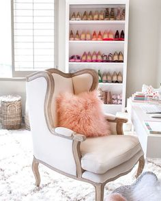 We can't decide what we're most obsessed about: the fluffy pink pillow, the gorgeous armchair, or the bright filled shoe shelf in the back. Follow us on #Pinterest for more decor tips and inspiration! #decor #inspiration #fashion #style #morninglavender