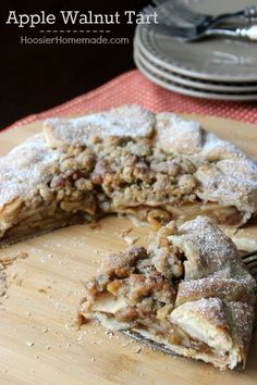 Easier than a traditional pie, this Rustic Apple Walnut Tart goes together quickly and has all the delicious flavors of Apple Pie! Pin to your Baking Board!