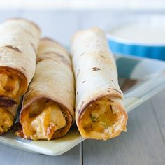 Baked Buffalo Ranch Chicken Taquitos with Blue Cheese Dipping Sauce Buffalo Chicken Taquitos but with wheat tortillas. - made them with the wheat tortillas, and they were delicious! I Love Food, Good Food, Yummy Food, Tasty, Yummy Snacks, Blue Cheese Dipping Sauce, Cheese Sauce, Chicken Taquitos, Taquitos Recipe