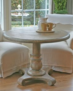 Round rustic painted french breakfast table with lovely scroll base