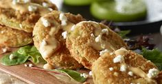 Fried green tomatoes are a tasty summer appetizer. Fry them to a golden brown using flour and panko breadcrumbs and top with goat cheese, ranch and Sriracha.