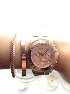 Marc by Marc Jacobs watch, Cartier Love bracelet.