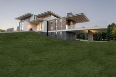 Exterior of modern house with glass featuring large terrace off living area
