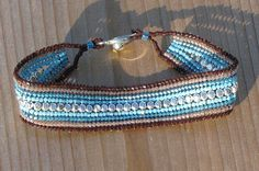 7 Inch BeadWoven Brown and Blue Bracelet  by CreationsbyWhiteWolf, $25.00