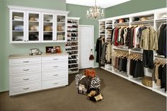 Nice use of color and chandelier in a huge master closet.