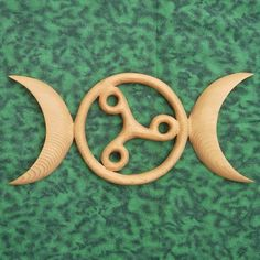 Triple Moon Triskele -Celtic Goddess Symbol - Birth Death Rebirth MEANING: The Moon phases represent the three aspects of the Celtic Goddess and the phases of the Life of Women: Maiden, Mother and Crone. The Triskele expresses the cycle of Birth, Death and Rebirth.    This is a great gift for the Wiccan, Moon Worshiping, Nature Path person in your world! $78.00