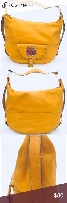 """💛MICHAEL KORS FULTON Large Hobo purse💛 Authentic Michael Kors Hobo Shoulder Pebbled Leather Bag, Color: Mustard Yellow. Small Front Snap Flap Pocket with MK emblem Polished Gold. 15"""" (L) x 12"""" (H) x 4"""" (W) with 9 inch Strap Drop. slight scratches on hardware (pictured), which go unnoticed unless looking closely. In Overall Great, Used Condition!!! Michael Kors Bags Hobos"""