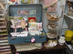 Scrapbook items displayed in a suitcase.