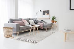 Warm interior with a traditional Scandinavian touch. Heavily inspired by the light grey with the light, pastel pink used to keep the interior neutral but warm. Pastel pink and light grey compliment the wood furniture and white walls. FAVOURITE: - Angled leg coffee table - Live plants - pastel pink/lilac