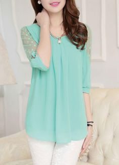 Very cute pastel mint green blouse with the detailed quarter sleeve and the white pants.