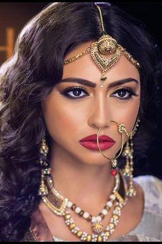 MU by:Roshni Jewels by:JG Jewellerey Long wavy black hair, nath (nose ringe), indian head piece