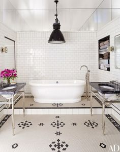 Meg Ryan NYC Loft Bathroom, Celebrity Home Designs, black and white bathroom, black and white tile, freestanding tub