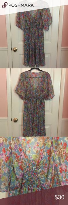 Sundance silk ruched floral sundress size 12 Sundance brand silk floral sundress with flattering ruched bodice and flutter sleeves. Multicolored floral pattern. Size 12 and fits true to size. Skirt is fully lined. 100% silk, lining: 100% polyester. Sundance Dresses
