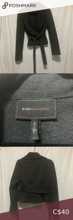 "BCBGMaxAzria cropped wide neck blazer DESCRIPTION: This amazing cropped wide neck, wide collar blazer by BCBG is amazing! It sits just below the waist and has a wrapped look to it with 2 small buttons to fasten and finished with a tie belt.   SIZE: Large MEASUREMENTS (laying flat): Bust: 18 1/2"" Waist: 16"" Length: 19"" (from shoulder) Sleeve: 24"" (from shoulder)  FABRIC: 70% polyester / 25% rayon / 5% spandex  CONDITION: Comes from SMOKE-FREE, CAT-FRIENDLY home 8/10: Loved but more to give…"