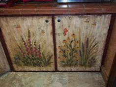 2 bottom kitchen cupboard doors.  I hand painted garden flowers on the doors.  Hollyhocks, Texas Bluebonnets, Liatrus,  Crocosmia, Grape Hyacinth and Black Eye Susans.  I also painted a butterfly and some bumble bees.