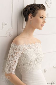 beaded off-the-shoulder bodice--gorgeous, but probably very uncomfortable, and she probably can't raise her arms very far!  wedding dress with sleeves  - Saboya