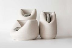 Martín Azúa and ceramicist Marc Vidal paired traditional artisan craft with raw natural materials in the Vase with Stone series. The duo created smooth, unique vases from white clay and then introduced a rough element of nature. Wonderful...  Read more: http://dornob.com/distorted-clay-vases-marry-nature-and-hand-craftsmanship/#ixzz3LhgQ8dkQ