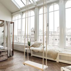 Swinging View  I would love a swing in my room! Would you?  #interiorsinspo #swing #loft #bedroom #bedroominspo #interiordesign #interiordecor #canopybed #inspiration #homeinspiration