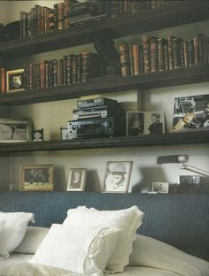 bookcase as headboard.  Hypothetical future dreamhouse's headboard: solved.