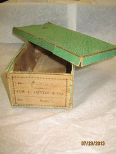 Archive photo: Bright green shoe box with a moire design. Circa 1850. Paper lining. Contained a pair of ivory kid boot style wedding shoes in the origainal box. Box is marked: 1 Pair of White Kid Side Lace  Manufactured by: JOS. L. JOYCE   CO.  Size 3 1/2  Width  S. Object ID: 2012.008.011.002. Gift of Mrs. Virginia T. Nickerson. As shown in the Music Room of the Historic Atwood House. #shoebox, #atwoodhouse, #chathamhistoricalsociety, #chatham, #capecod