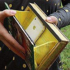 Making an old book into a clutch. Repurposing old books is great.
