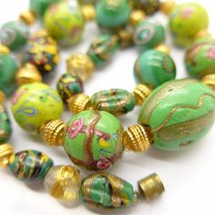 ANTIQUE VINTAGE VENETIAN LAMPWORK FANCY ROSE AVENTURINE GLASS BEAD NECKLACE  I found two of those beads with the gold squiggles in Gaza.